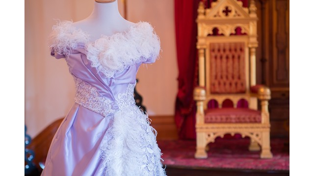 Reproduction of Queen Liliuokalani's ostrich feather gown on display